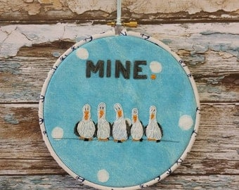 "Original hand embroidered hanging art, with seagulls and ""mine"""