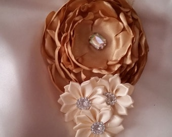 Handmade Gold layered melted rosette with Ivory Cluster Flowers on a Ivory lace Headband accented with a Rhinestone