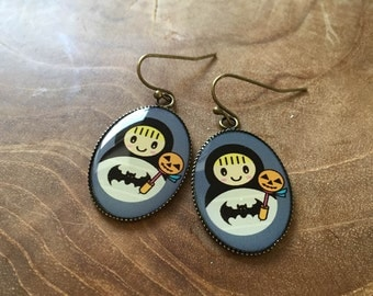 Dangeling Matryoshka earrings 2: grey, black, white and orange. One of a kind. Halloween Batman