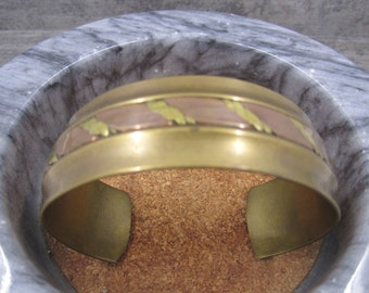 A solid wide brass cuff