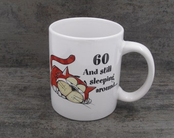 "Russ Berrie & Co  - "" 60 and still sleeping around...""   mug"