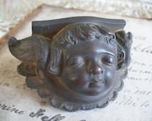 Antique cherub casting, architectural salvage, furniture trim