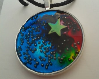 """Necklace - Original resin design """"Shooting Star"""" in a silver plated bezel on a black cord"""