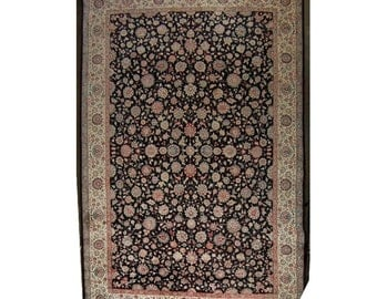 7604 Black Persian Rug Adorned with Flowers c. 1910