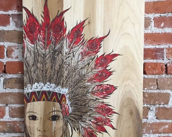 Original Indian Warrior burned onto poplar wood! Amazing detail throughout, glass beaded headband, acrylic snd stain accented feathers.