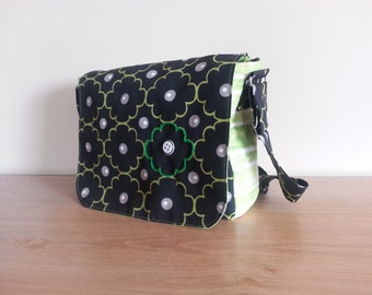 Messenger bag with adjustable handle