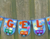 Reserved for Isabella. Felt name banner with train motif.