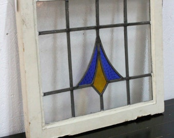 Vintage /antique stained glass window, blue and yellow/orange design