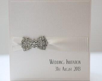 Art Deco Bow Pocket Invitation in Ivory