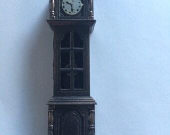 Vintage Grandfather clock figurine, is also a pencil sharpener