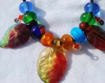 Glass Lampwork Beads ~ Glass Lampwork Fall Leaves ~ Autumn Lampwork Beads ~ Handcrafted Lampwork Leaf Beads ~ SRA ~ USA ~ blue orange green