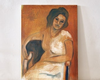 An original oil painting of a seated woman
