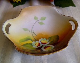 Nippon Hand Painted Small Yellow And Brown Bowl With White Floral Design.