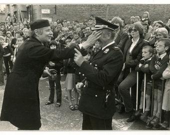 Making fun of the officer - original 1980s vintage press photo- event- audience- Kortrijk, Belgium- paper ephemera