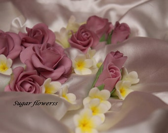 Handmade sugar flowers for wedding cake decoration. edible fondant and gumpaste cake toppers. sugar flowers  lilac blue purple  white pink