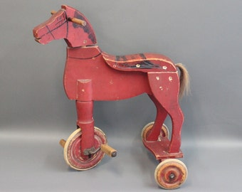 Antique three wheeled bike-horse