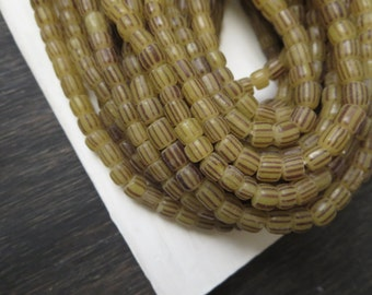 small matte striped seed beads ,yellowish grey glass beads ,Irregular barrel tube , New Indo-pacific  3 to 6mm / 10 inch strand ,3BBGL7-22