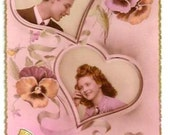 Vintage - LOVERS, HEARTS, PANSIES- Sweet fashion Couple -years 1950- French real Photo Postcard, written- Pink background- 2 tiny bugs holes