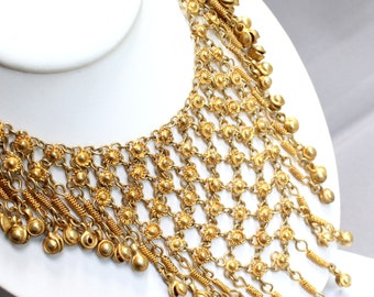 Heavy vintage kuchi style gold metal bib necklace with dangling baubles