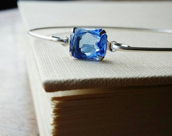 Light Sapphire Blue Jewel Silver Charm Bangle . Stackable Silver Bracelet . Stacking Blue Gem Bracelet September Stone