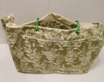 Megan Carry-All in cream leaf pattern on light sage green upholstery fabric with a cream lining