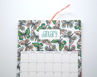 2016 Wall Calendar, size 8.5x11 inches featuring 12 different floral and butterfly illustrations in green, peach, aqua, coral, pink and gray