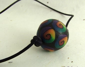 Rainbow spiral bead necklace, handmade polymer clay bead on black satin cord