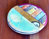 "SkateSpot Trivet - Single - Made by Deckstool. Large Recycled Skateboard wood 7"" Diameter coaster, hotplate, charger. Colorful, skateboarder"