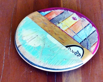 """SkateSpot Trivets - Made by Deckstool. Large Recycled Skateboard wood 7"""" Diameter coaster, hotplate, charger. Colorful, skateboarder"""