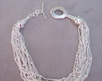 Ten Strands of Liquid Silver with Finials Bracelet