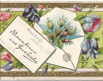 Envelope filled with pink roses Violets decorate this Vintage Postcard Greetings Remembrance and Good Wishes 1909