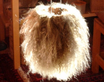 Mongolian sheep skin bag for keeping small change or crystals in or as a wall hanging