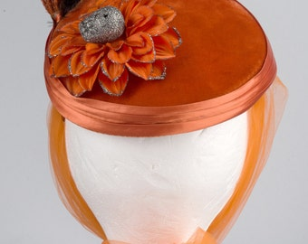 OOAK Orange Fascinator embellished for Halloween. Black rose, skull, spiders