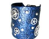 Steampunk leather bracelet , metallic blue custom cuff with gears ,silver sprockets adjustable straps ,100% handmade