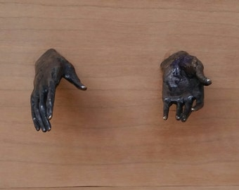 "Cabinet and drawer pulls 2"" long small bronze hands with 1"" screw"