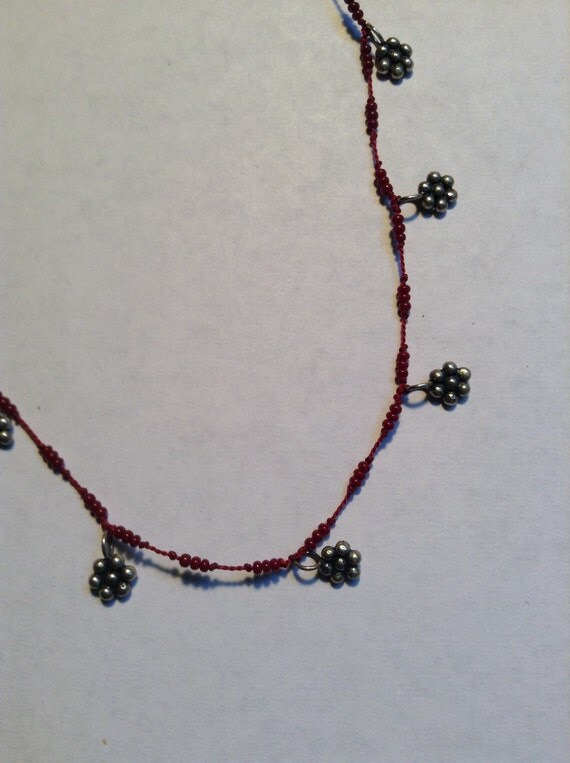 silk thread with tiny seed and sterling silver