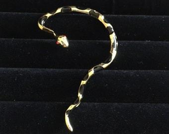 Gold and black snake ear cuff earring - left ear