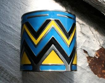 Wide Cuff bracelet. Shiny Silver w/ Black Blue and Yellow 3-D Chevron Zig Zag Design. Vintage Futuristic! Mod. UNIQUE Design. Adjustable.