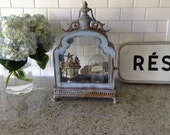 Unique blue rusty glass display case French inspired