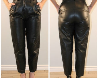 Vintage black leather pants high waisted with front pleating and pockets tapered  1980 small