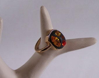 Black ring Yellow and orange Swarovski crystals golden mount Size Q (UK) 8 (US) cristal clay