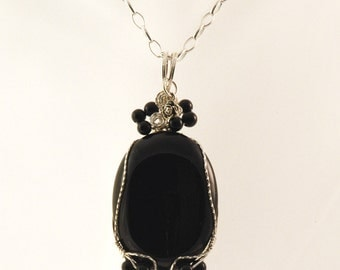 Black Beauty's Onyx Necklace with a Sparkle of Sterling Silver