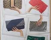 In my clutches! Assortment of Women's clutches pattern Simplicity 2166 uncut