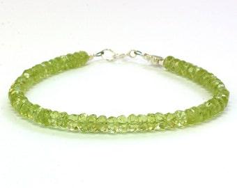 Citrus green peridot gemstone bracelet; AA grade faceted rondelles; Genuine gemstone bracelet; Sterling silver clasp and accent flower