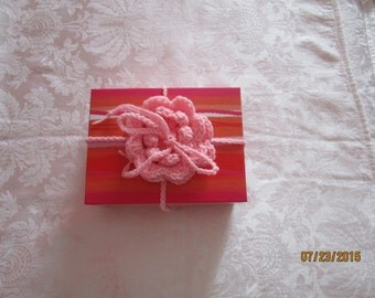Crocheted flower package bow