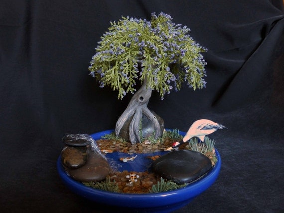 Koi pond with artificial bonsai waterfall and japanese crane for Artificial fish pond