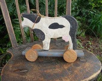 rustic farmhouse primitive wood cow child's toy with wheels and bell