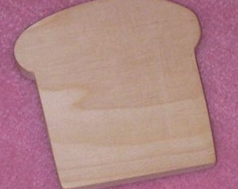 Cutting board shaped as a loaf of bread