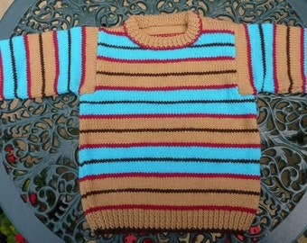 Handknitted child sweater with stripes. Warm knitted toddler cardigan.
