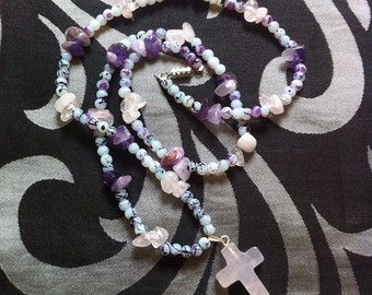 Handmade rose quartz and amethyst chip bead necklace with rose quartz cross pendant and glass drawbench beads.